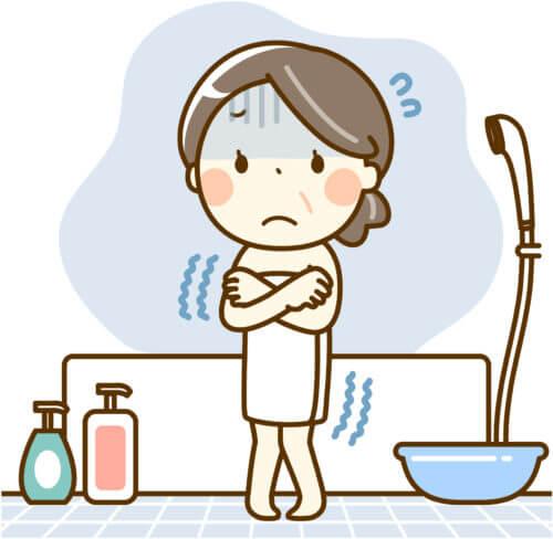 お風呂の追い焚きができなくて震える女性